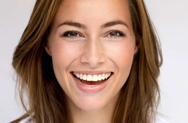 Beautiful woman smiling after cosmetic dentistry at D.A Dental in Auburn, MA
